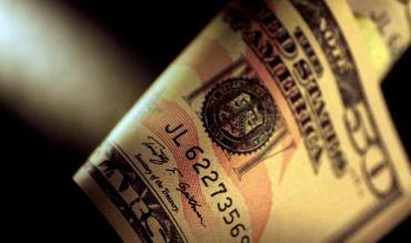 El dólar tocó el piso de la banda y el Central salió a comprar US$ 20 millones