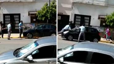 Video increíble: estacionó mal, la multaban y atropelló y arrastró 300 metros al agente de tránsito